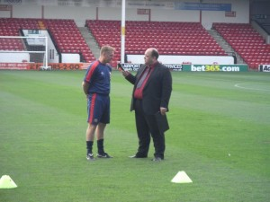 Interviewing Dean Smith at an Open Training Session on 2nd August 2011. Photo by Dave Gittins